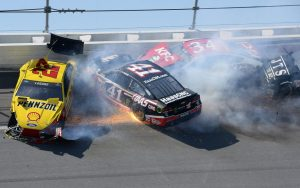 May 4, 2014; Talladega, AL, USA; NASCAR Sprint Cup Series drivers Joey Lagano (22), Kurt Busch (41), David Ragan (34) and Michael McDowell (95) wreck at Talladega Superspeedway. Mandatory Credit: Mike DiNovo-USA TODAY Sports ORG XMIT: USATSI-165200 ORIG FILE ID:  20140504_pjc_ad4_312.JPG
