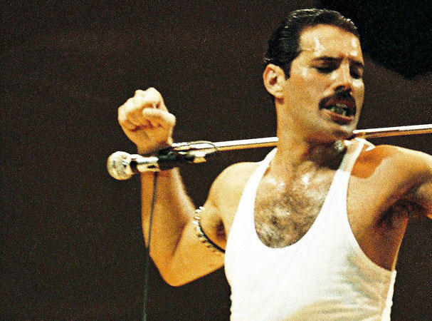LONDON, UNITED KINGDOM - JULY 13: Freddie Mercury of Queen performs on stage at Live Aid on July 13th, 1985 in Wembley Stadium, London, England (Photo by Peter Still/Redferns)